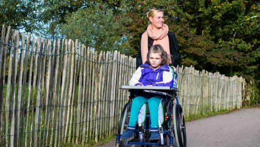 47991013 - disabled child and a wheelchair with care assistant